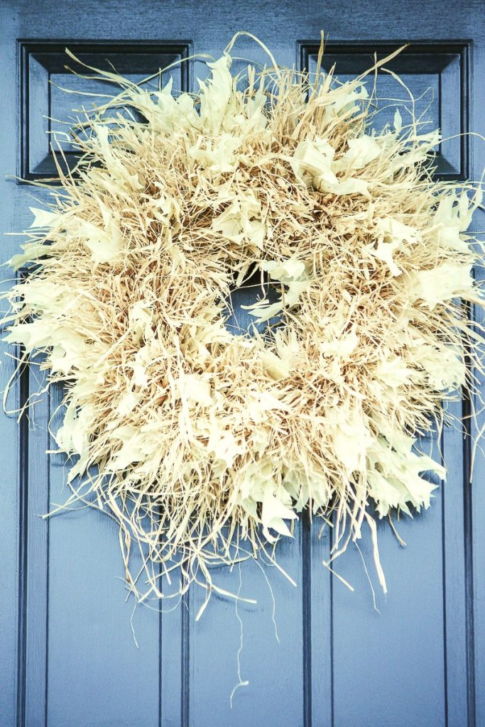 full and wild raffia wreath with bleached white oak leaves