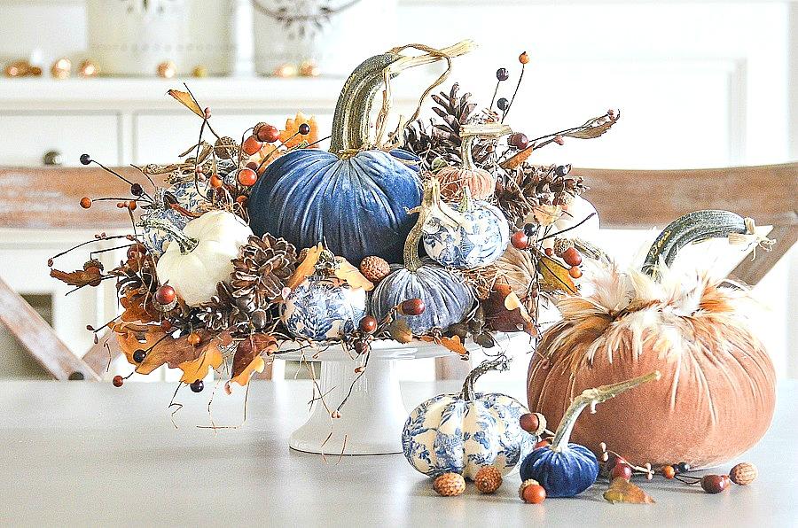 beautiful pumpkin arrangement on a white cake pedestals