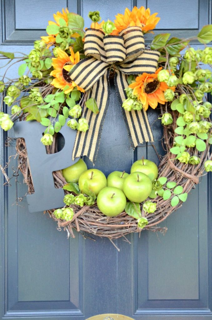 wreath with apples and sunflowers on a blue door