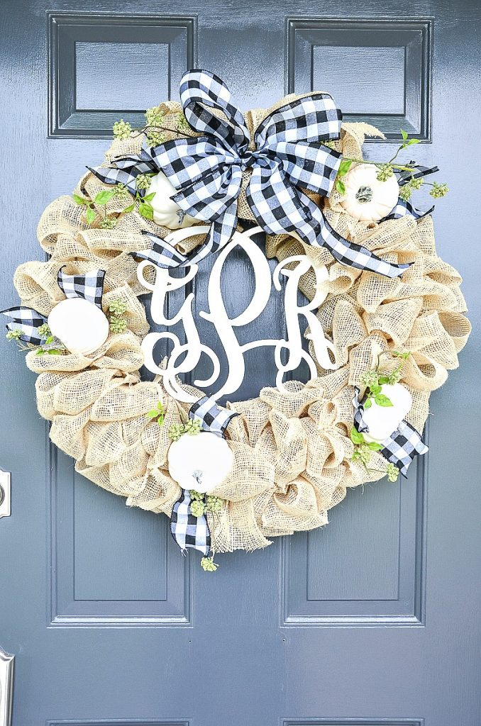 burlap and pumpkin wreath with a black and white checked bow