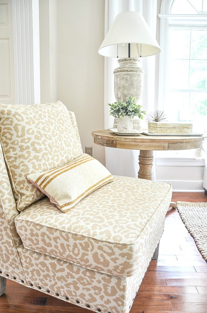 chetah fabric on accent chair in the living room