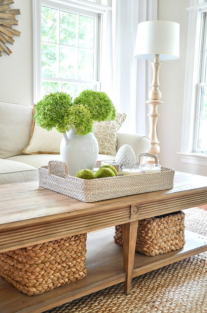 coffee table with pretty vignette in a basket in the living room