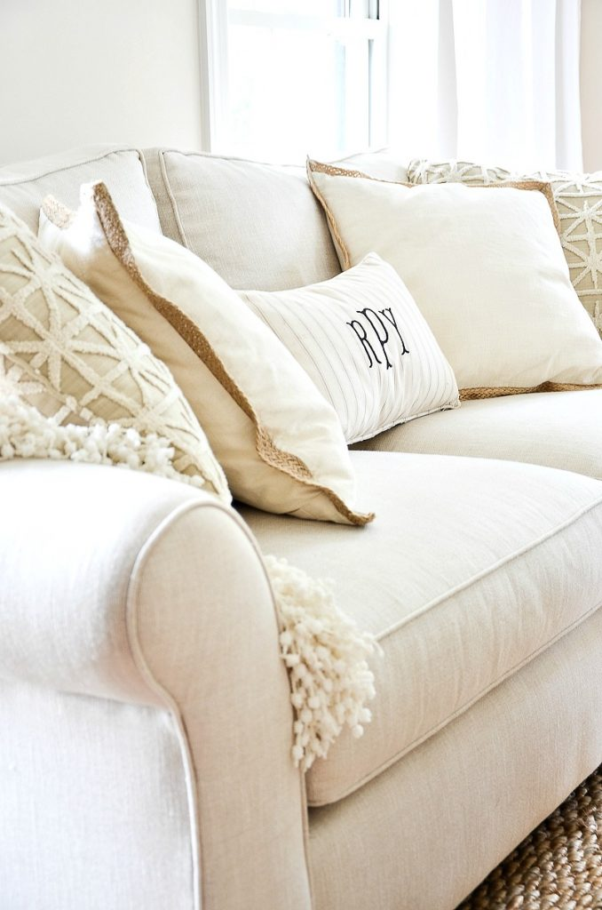 neutral pillows on a sofa in the living room