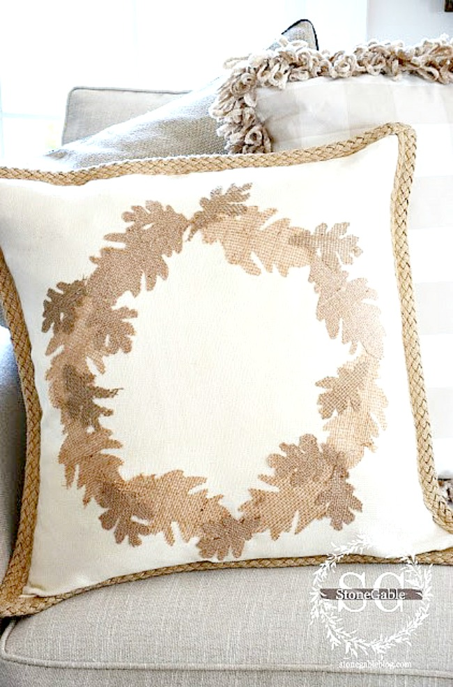 pillow with a wreath of leaves on them