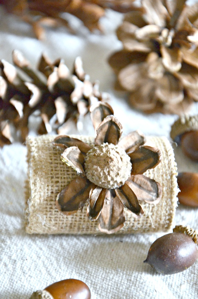 napkin ring made out of burlap. acorns and pinecones
