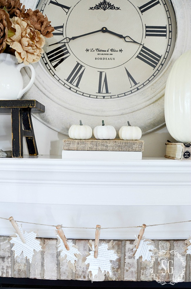 white pumpkins on a mantel