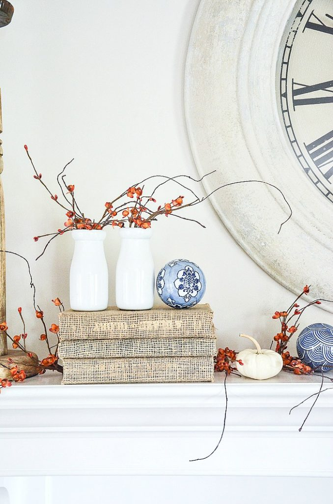 fall decorating a mantel with bittersweet and blue and white porcelain balls