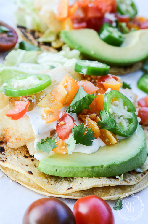 colorful fish tacos with chopped tomatoes