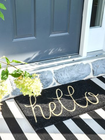 door mat with black and white striped rug