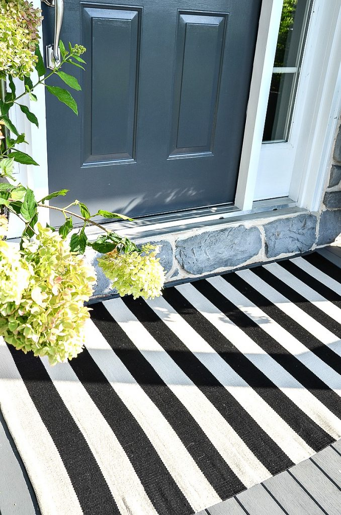 black and white striped rug at front door