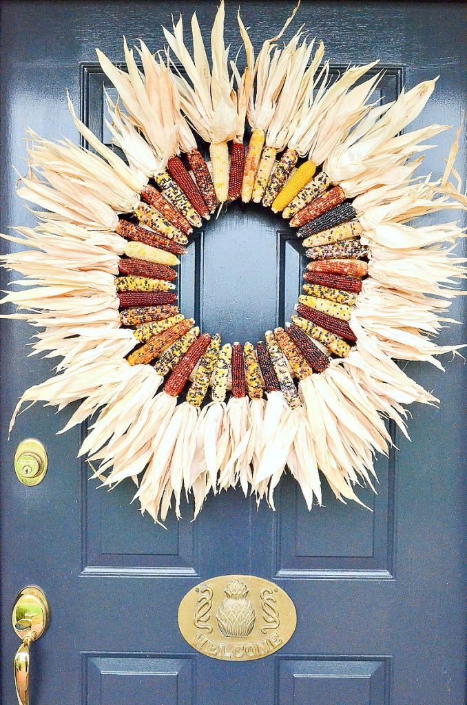 baby corn wreath on a blue door