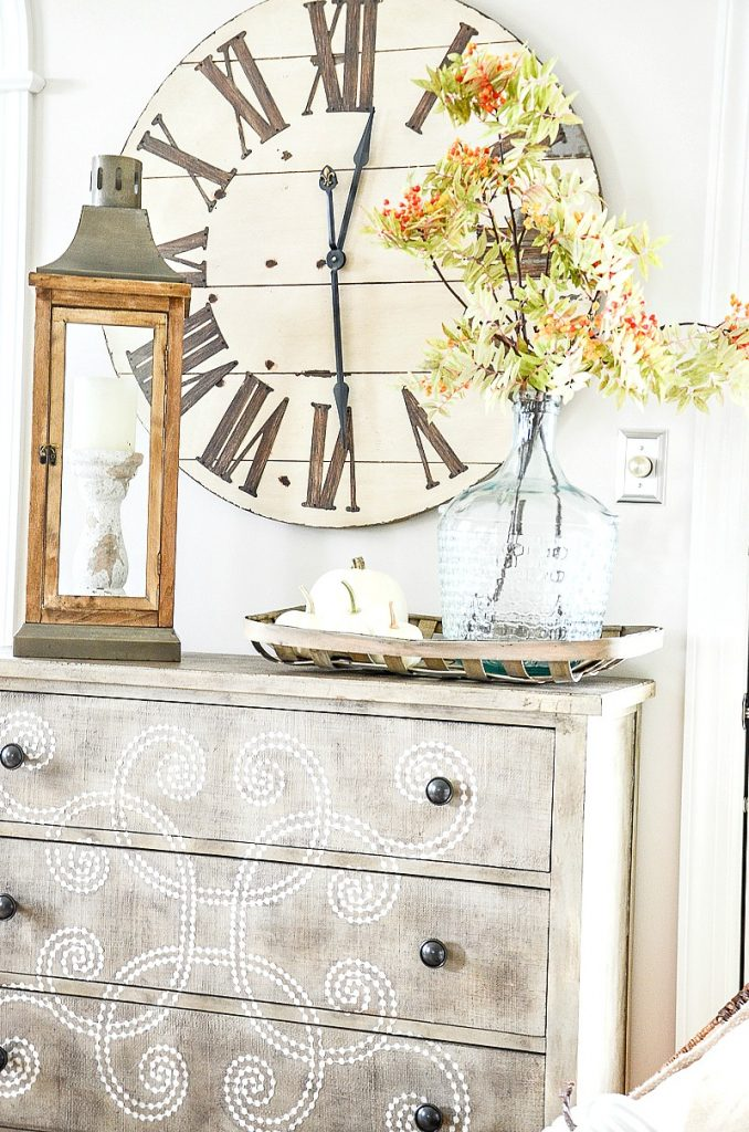 chest with large clock on top of it in a fall home tour