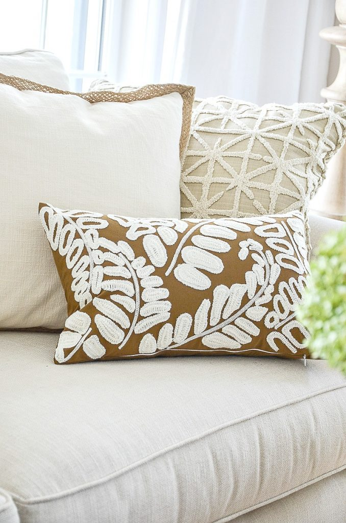 trio of fall pillows on a sofa