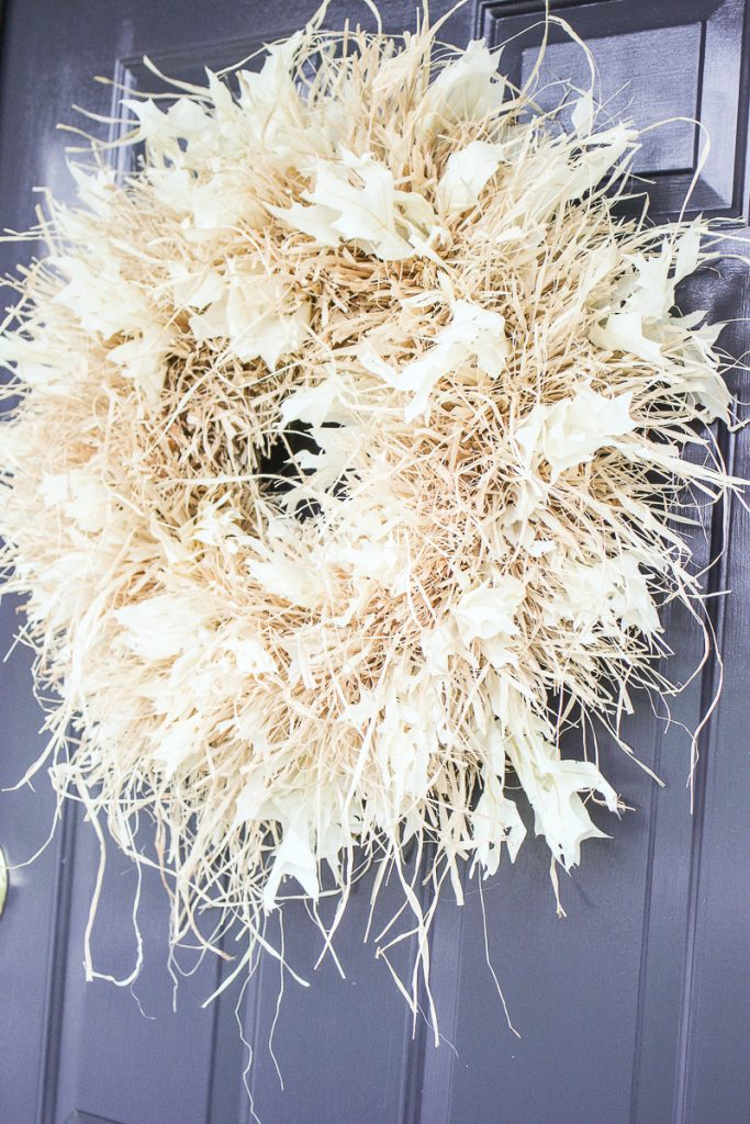 big, fluffy white raffia wreath with bleached oak leaves