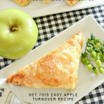 apple turnover on a white plate with a green apple