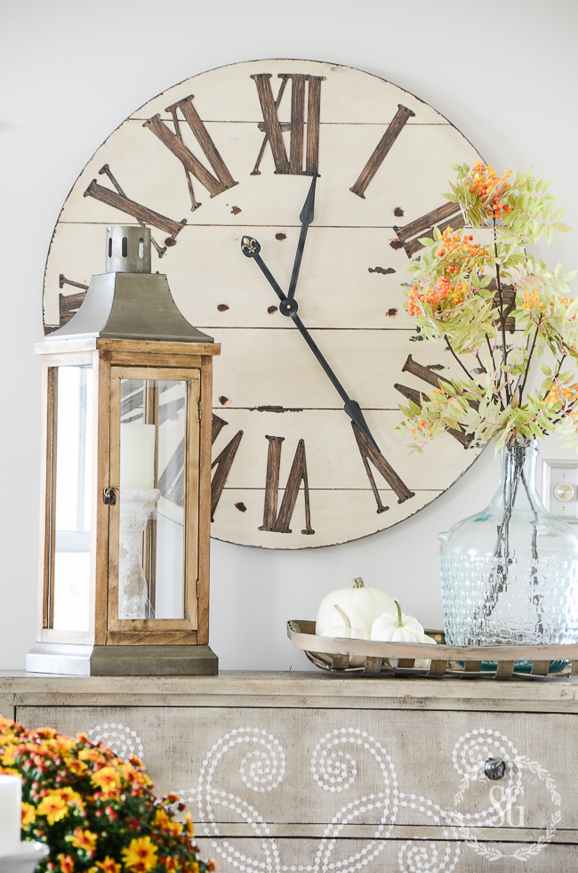 large clock with rustic lantern