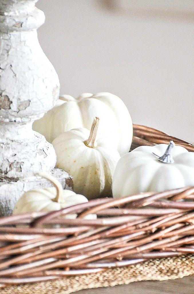 white mini pumpkins in a fall vignette