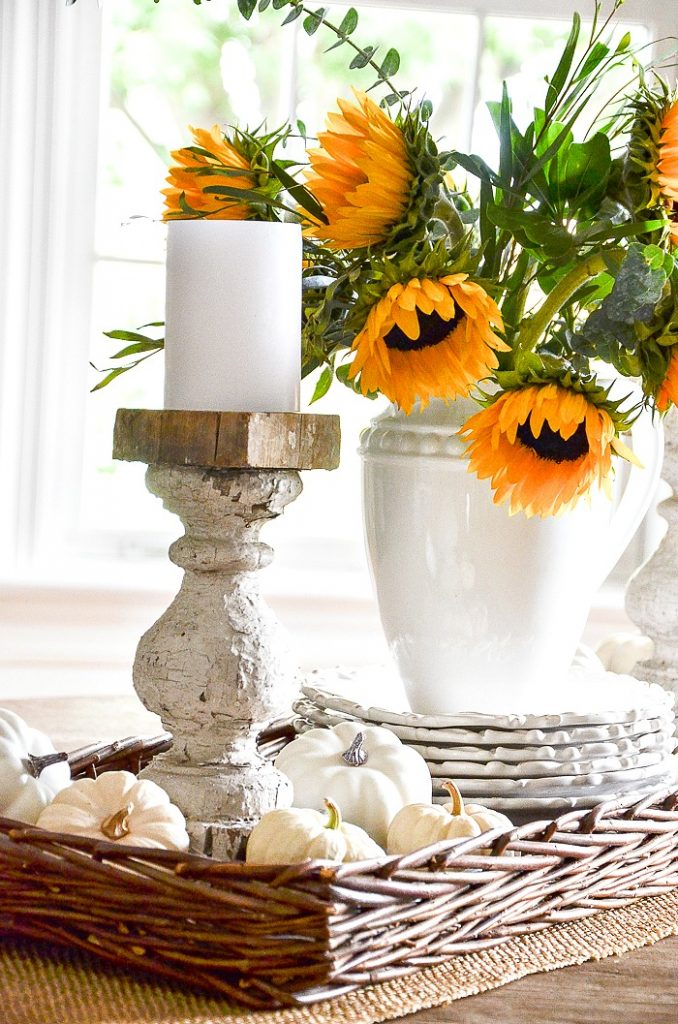 white pumpkins in the bottom of a fall vignette tray