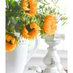 sunflowers in a white urn in a vignette