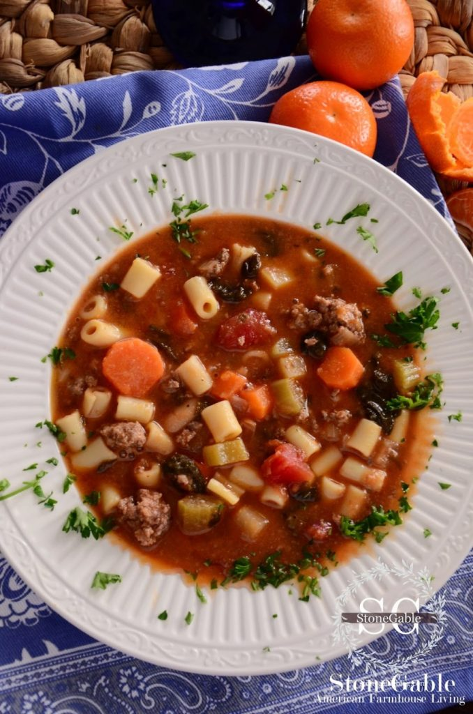 MINISTRONE SOUP IN A WHITE BOWL