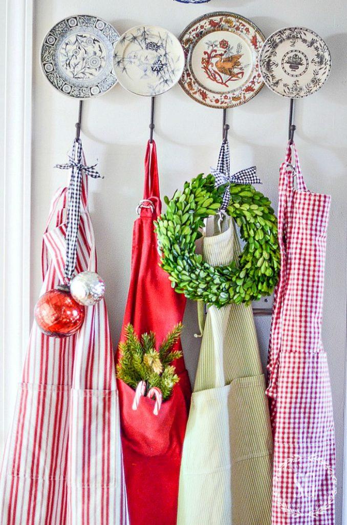 Christmas aprons on hooks