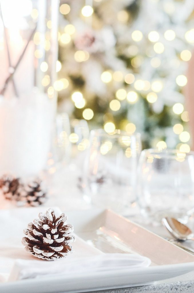 frosted pinecones on a Christmas tablescape