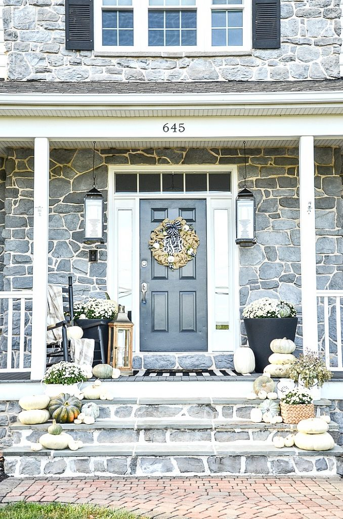 fall front porch with white pumpkins and white mums