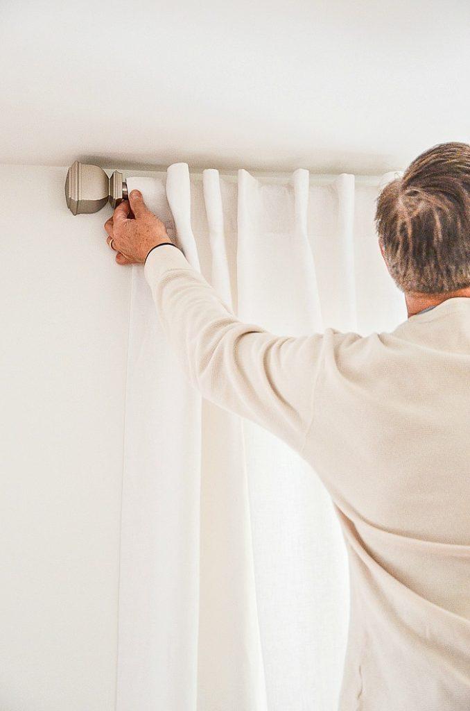 man measuring a window