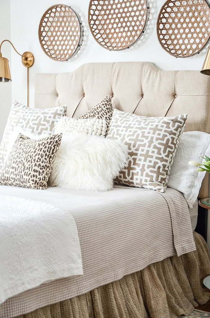cozy bed with lots of pillows