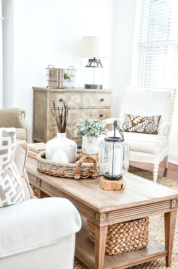 coffee table with a fall vignette on it