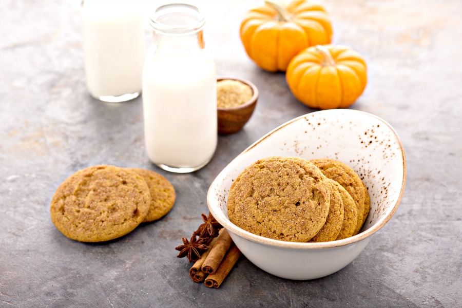 pumpkin spice cookies in a little bowl with a small milk bottle of milk with a straw
