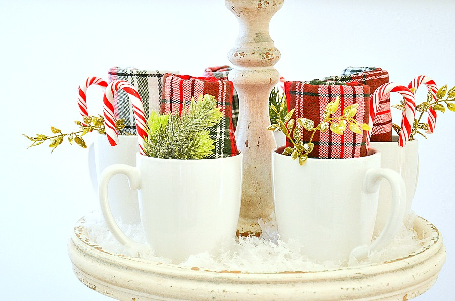 white mugs with candy canes and evergreen