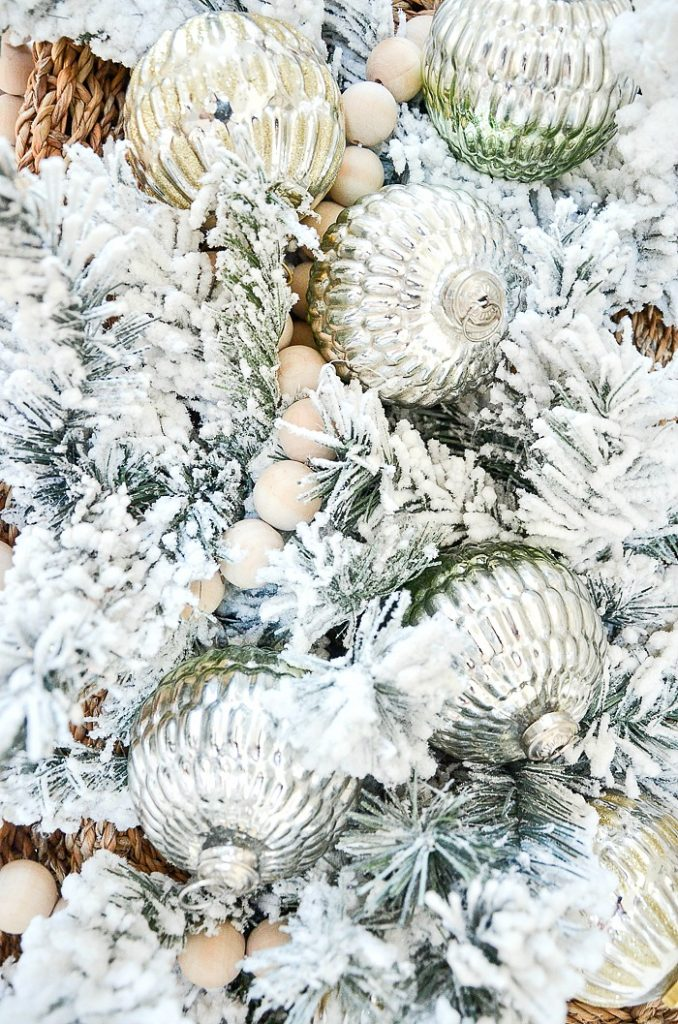 christmas balls in frosted evergreens