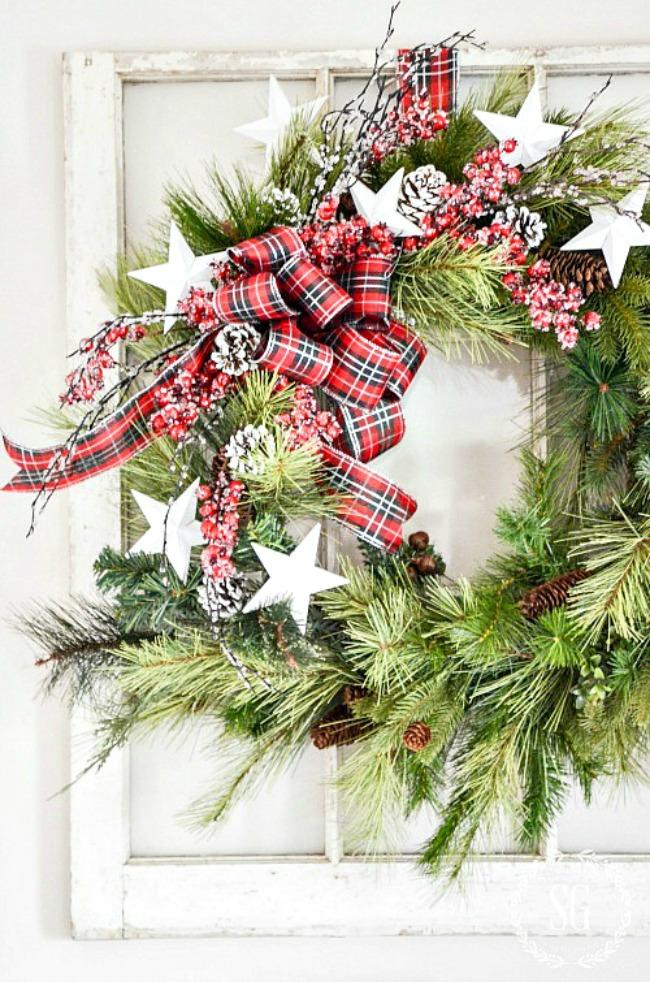Christmas wreath on a white window