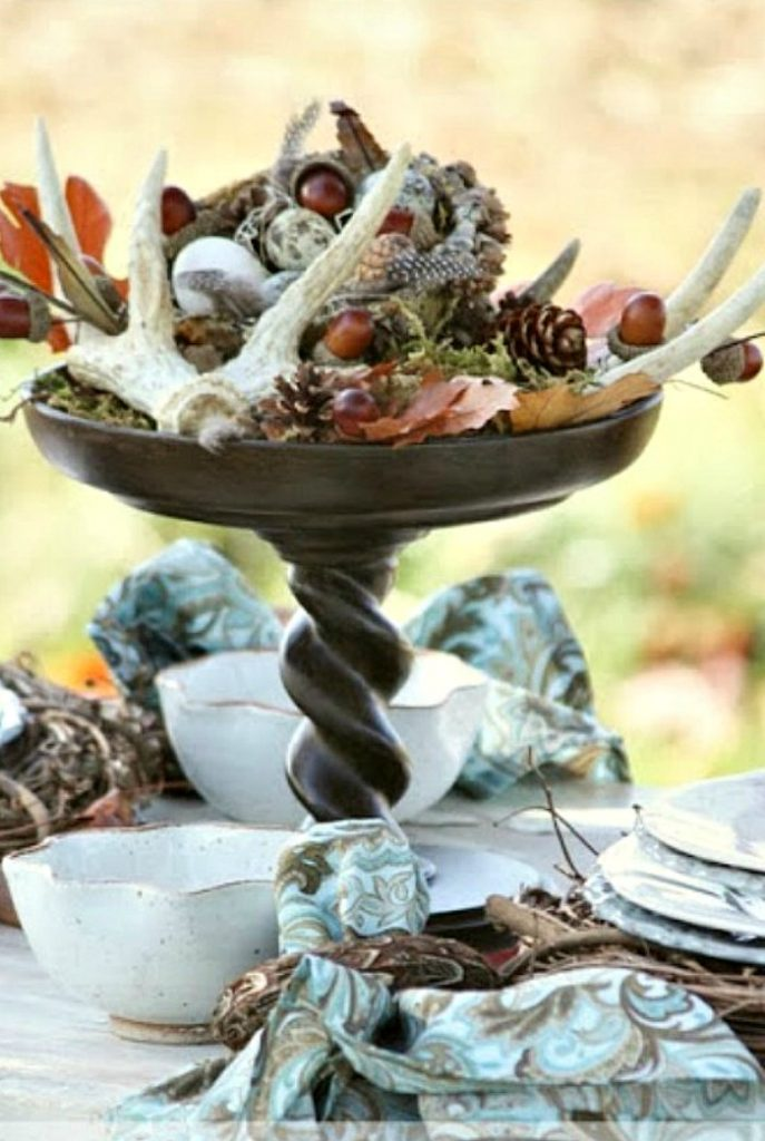 pretty fall inspired centerpiece with deer sheds, acorns, moss and fall leaves