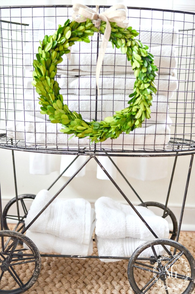 Christmas boxwood wreath on a laundry basket