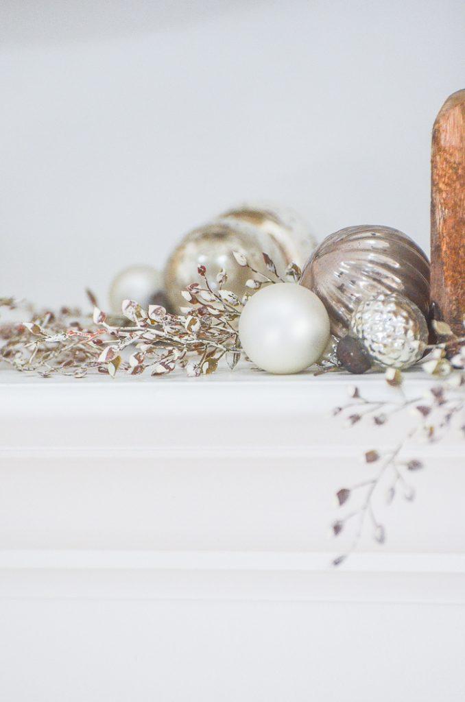 mercury glass ornaments on a mantel