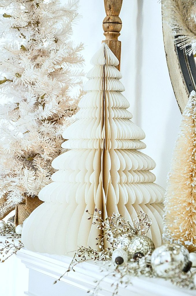white paper tree trimmed with silver glitter