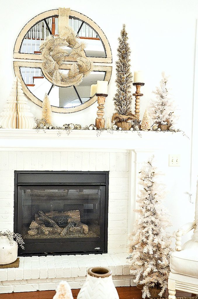 Christmas mantel with trees and chunky candlesticks