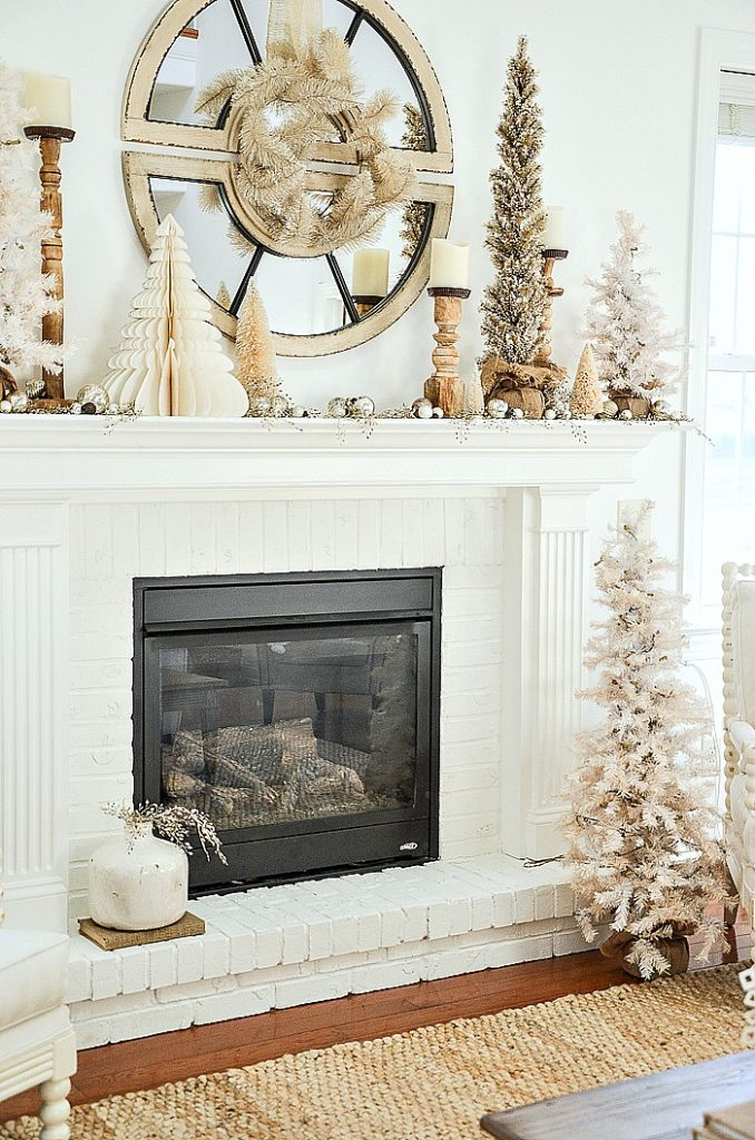 Christmas mantel with trees and candles
