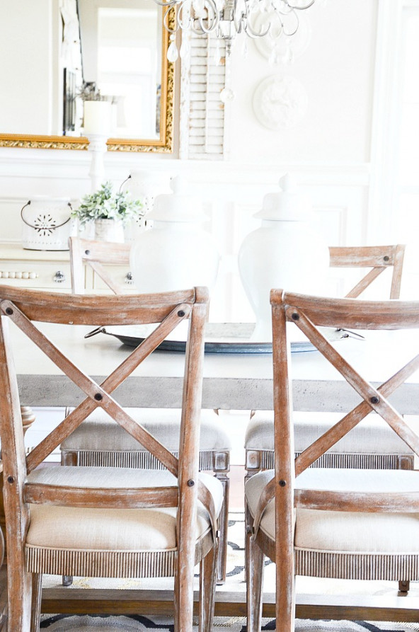 french backed chairs at a concrete dining room table
