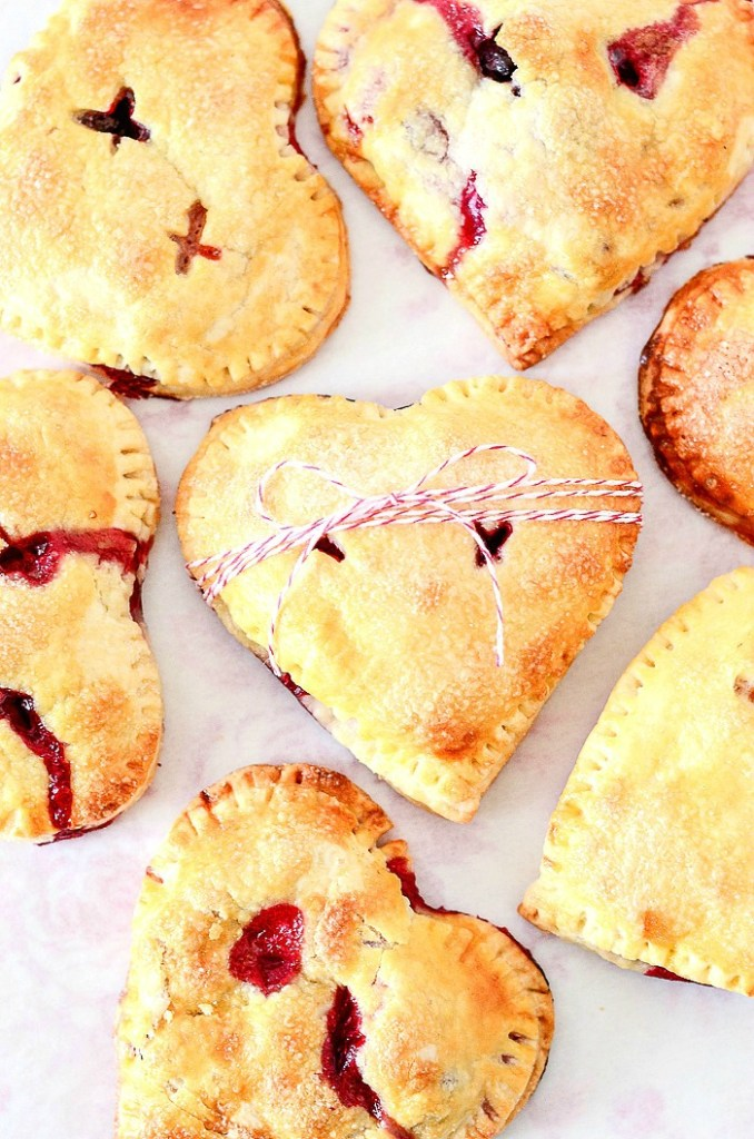 scrumptious valentine hand pies on a pink cloth