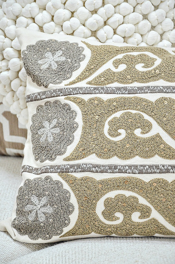 detail of gray, gold and ivory pillow