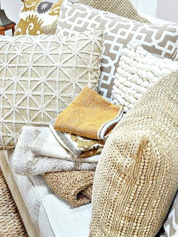 pile of neutral pillow covers