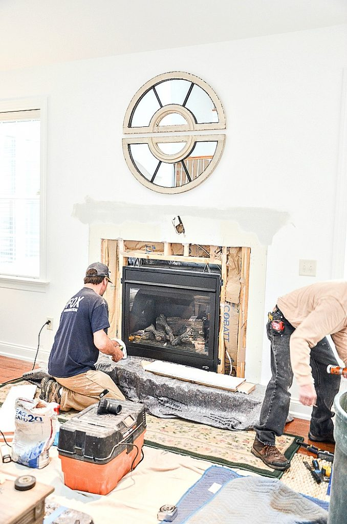 construction workers building a fireplace