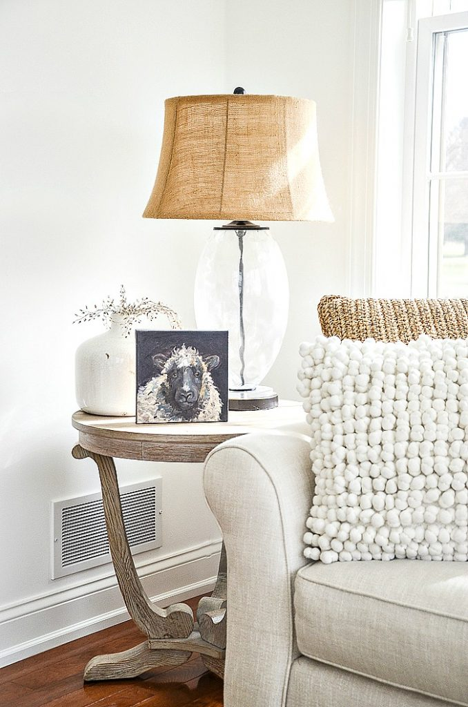 lamp with a burlap shade on a table