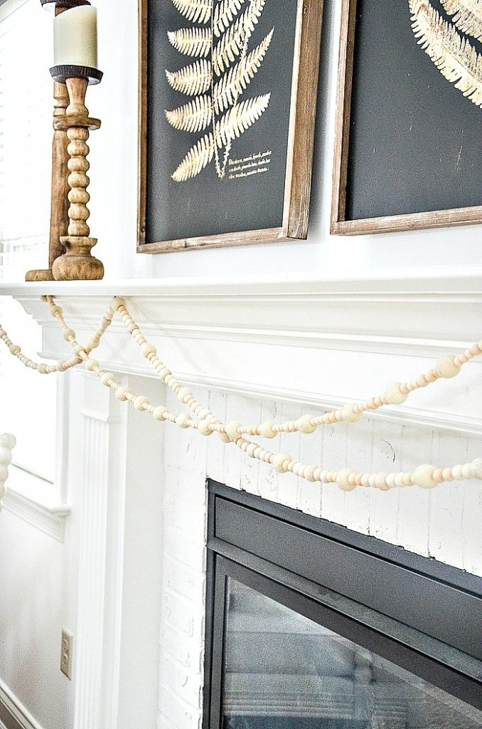 3 strands of garland on a mantel
