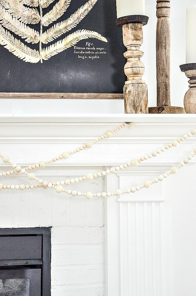 white wooden beads and wool ball garland