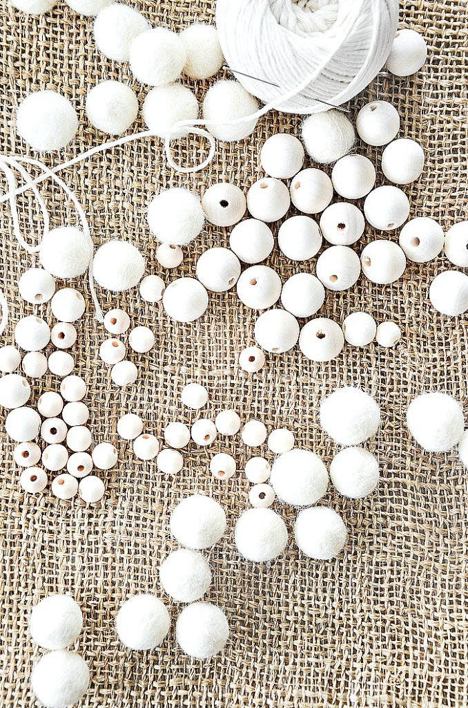 materials to make a wooden bead and wool ball garland