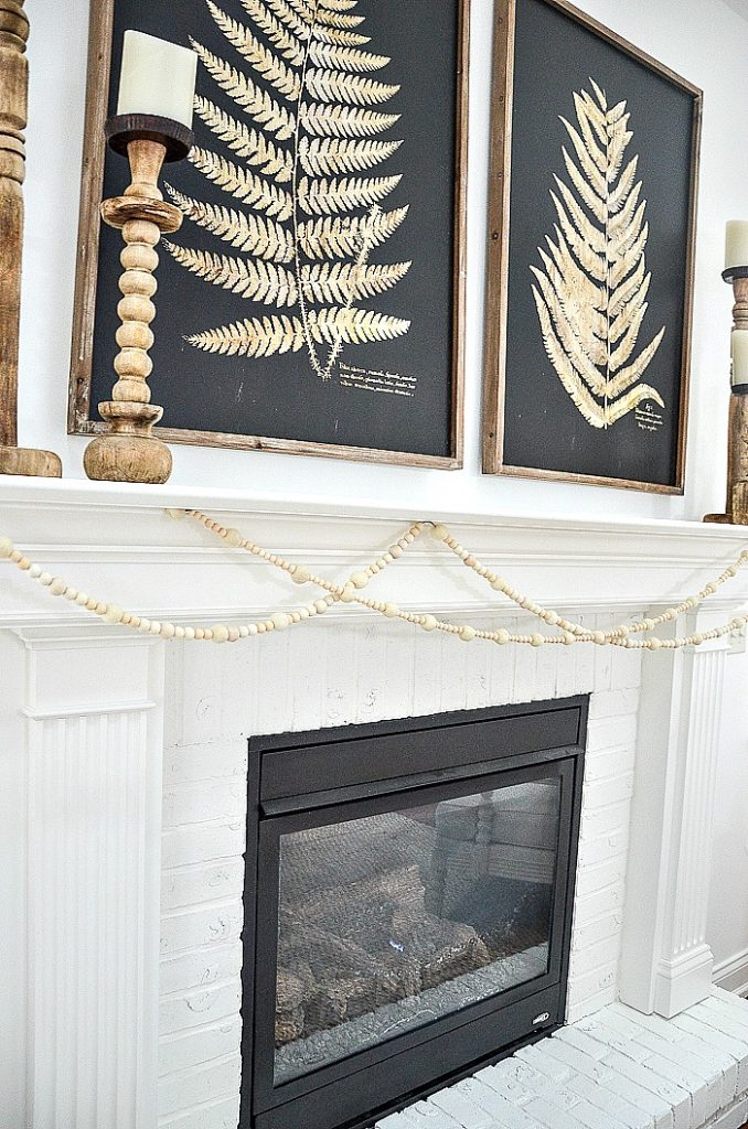 mantel with winter white bead and wood ball garland